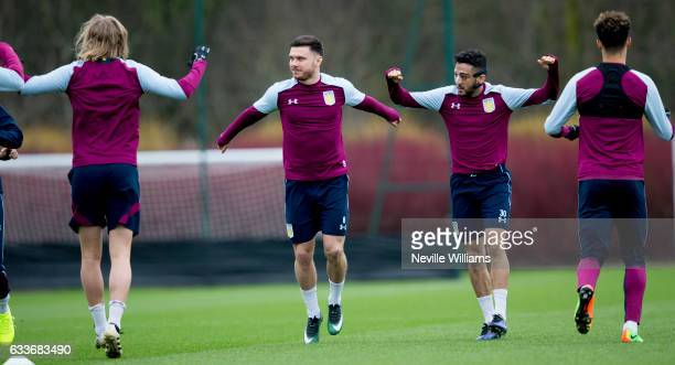 Scott Hogan of Aston Villa in action with team mate Niel Taylor during a Aston Villa training session at the club's training ground at Bodymoor Heath...