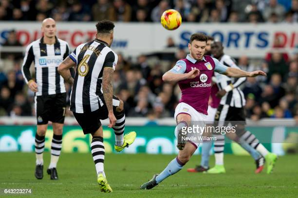 Scott Hogan of Aston Villa is challenged by Jamaal Lascelles of Newcastle United during the Sky Bet Championship match between Newcastle United and...