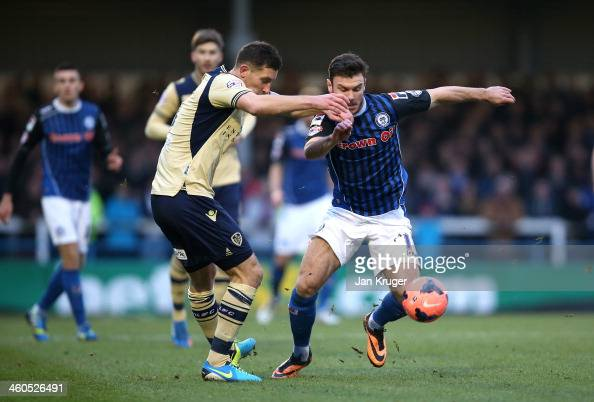 Scott Hogan of Rochdale AFC battles with Jason Pearce of Leeds during the Budweiser FA Cup third round match between Rochdale and Leeds United at...