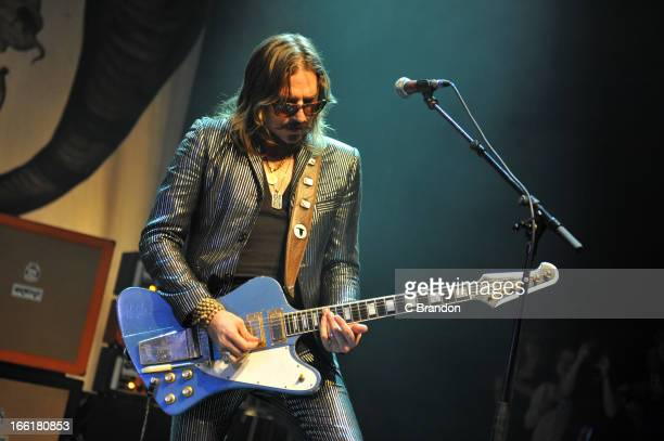 Scott Holiday of Rival Sons performs on stage at O2 Shepherd's Bush Empire on April 9 2013 in London England