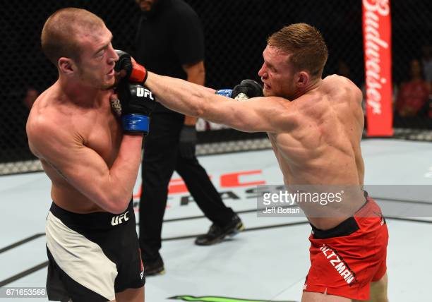 Scott Holtzman punches Michael McBride in their lightweight bout during the UFC Fight Night event at Bridgestone Arena on April 22 2017 in Nashville...