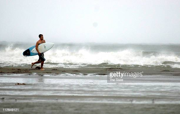 Scott Howell of Folly Beach returns from surfing off of Sullivan's Island as waves are kicked up by tropical storm Ernesto in Sullivan's Island South...