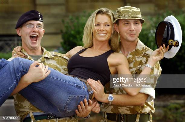 Scott Hunter of the Second Signals and Tommy Graham of Second Brigade both from Ayr pose with model Nell McAndrew at the County Hall in Ayr to help...