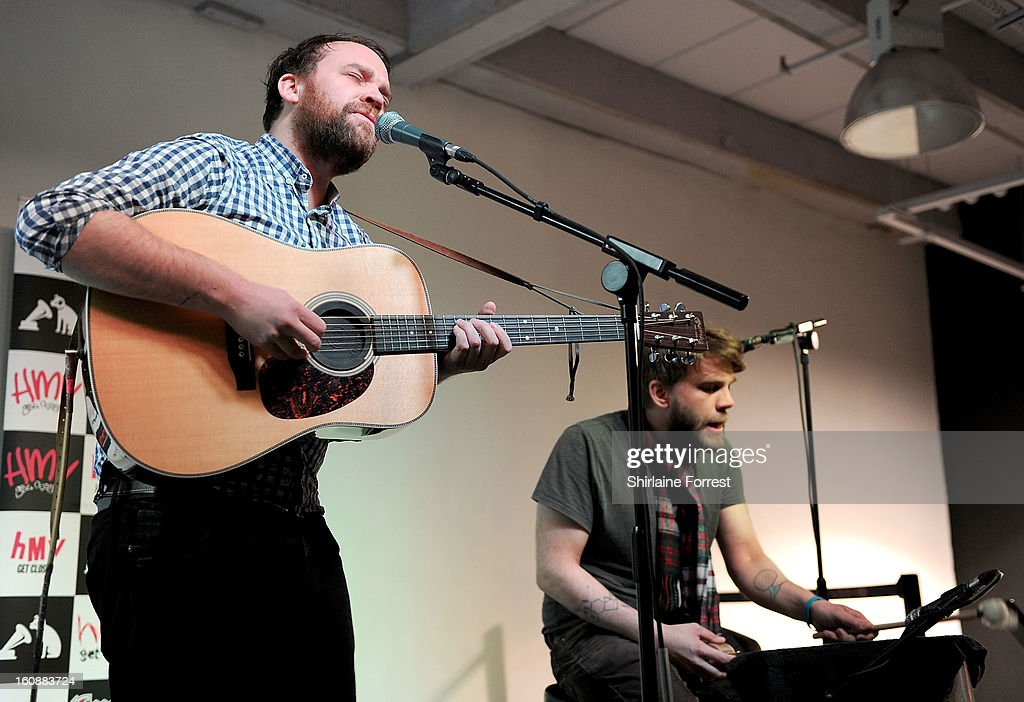 Scott Hutchison and Grant Hutchison of Frightened Rabbit perform live and sign copies of their new album 'Pedestrian Verse' at HMV Market Street on February 6, 2013 in Manchester, England.