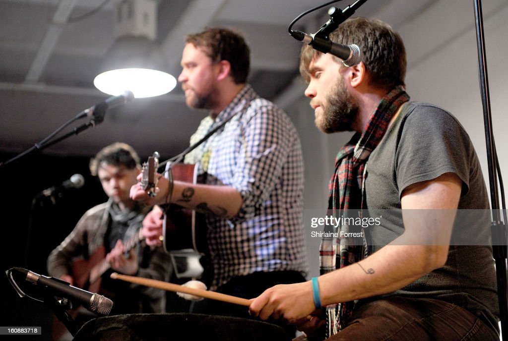 Scott Hutchison, Grant Hutchison and Gordon Skene of Frightened Rabbit perform live and sign copies of their new album 'Pedestrian Verse' at HMV Market Street on February 6, 2013 in Manchester, England.