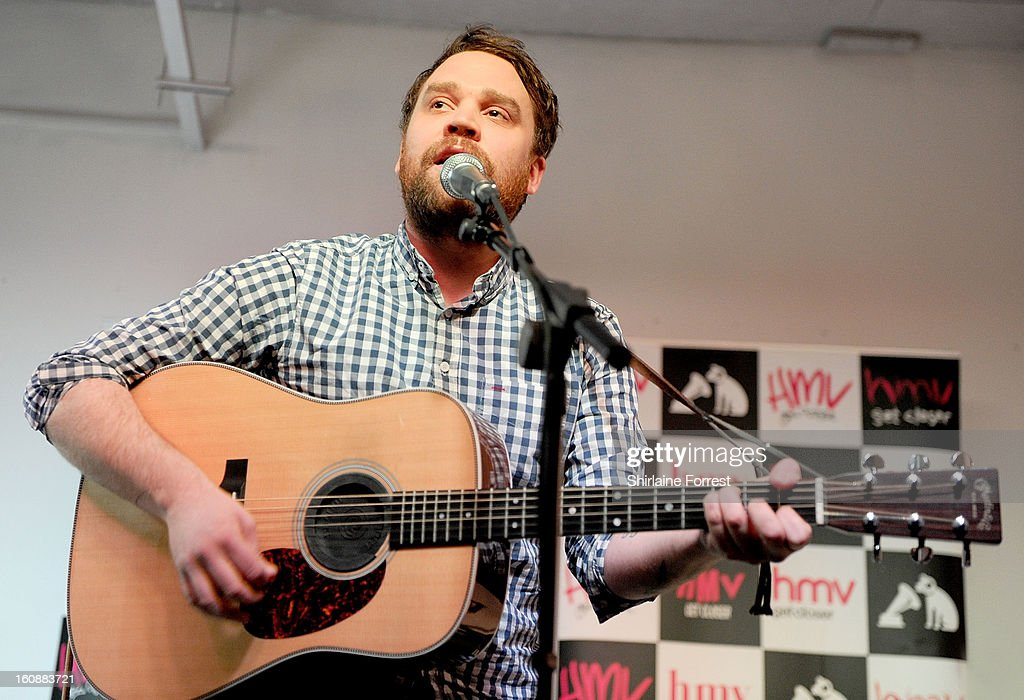 Scott Hutchison of Frightened Rabbit perform live and sign copies of their new album 'Pedestrian Verse' at HMV Market Street on February 6, 2013 in Manchester, England.