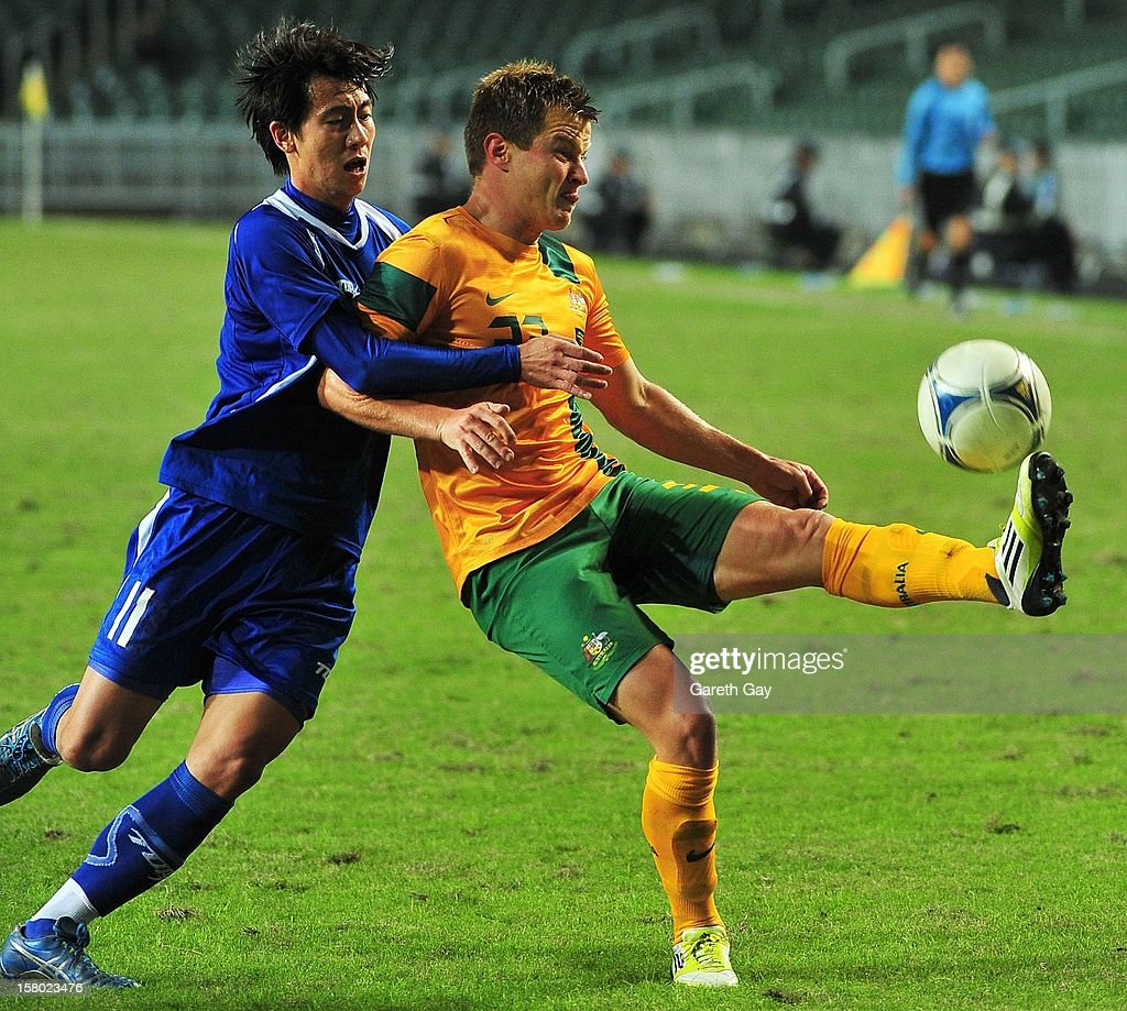 Scott Jamieson (R) of Australia controls the ball during the EAFF East Asian Cup 2013 Qualifying match between Chinese Tapei and the Australian Socceroos at Hong Kong Stadium on December 9, 2012 in So Kon Po, Hong Kong.