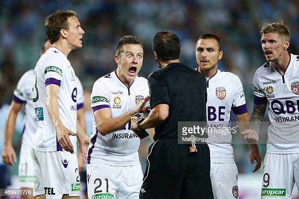 Scott Jamieson of Perth Glory argues with the referee after a penalty was given whick led to the first goal during the round 10 ALeague match between...