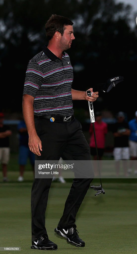 Scott Jamieson of Scotland acknowledges the crowd after winning The Nelson Mandela Championship presented by ISPS Handa in a three way play-off against Steve Webster of England and Eduardo de la Riva of Spain at Royal Durban Golf Club on December 9, 2012 in Durban, South Africa.