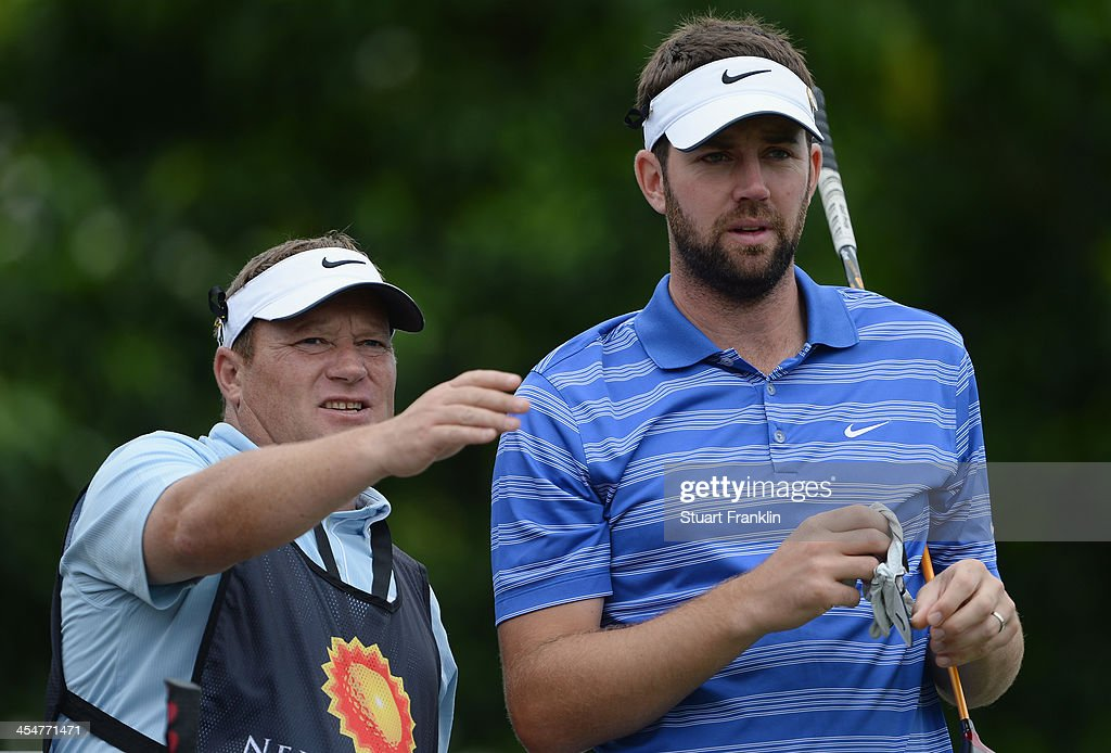 Scott Jamieson of Scotland and caddie discuss a shot during the pro-am prior to the start of the Nelson Mandela Championship presented by ISPS Handa at Mount Edgecombe Country Club on December 10, 2013 in Durban, South Africa.