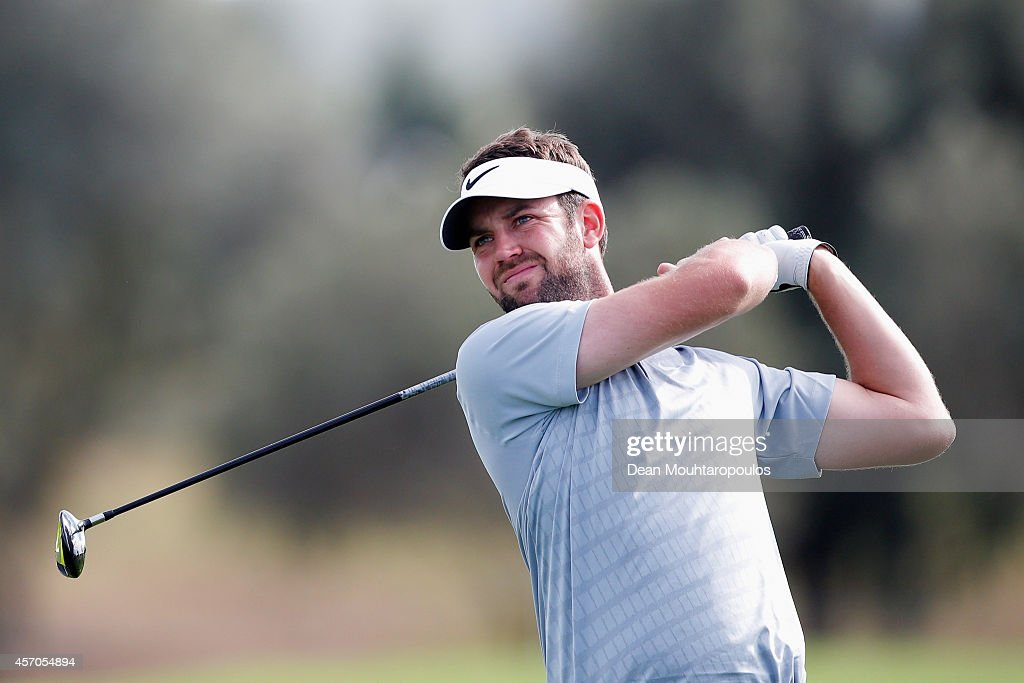Scott Jamieson of Scotland hits his second shot on the 17th hole during Day 3 of the Portugal Masters held at the Oceanico Victoria Golf Course on...