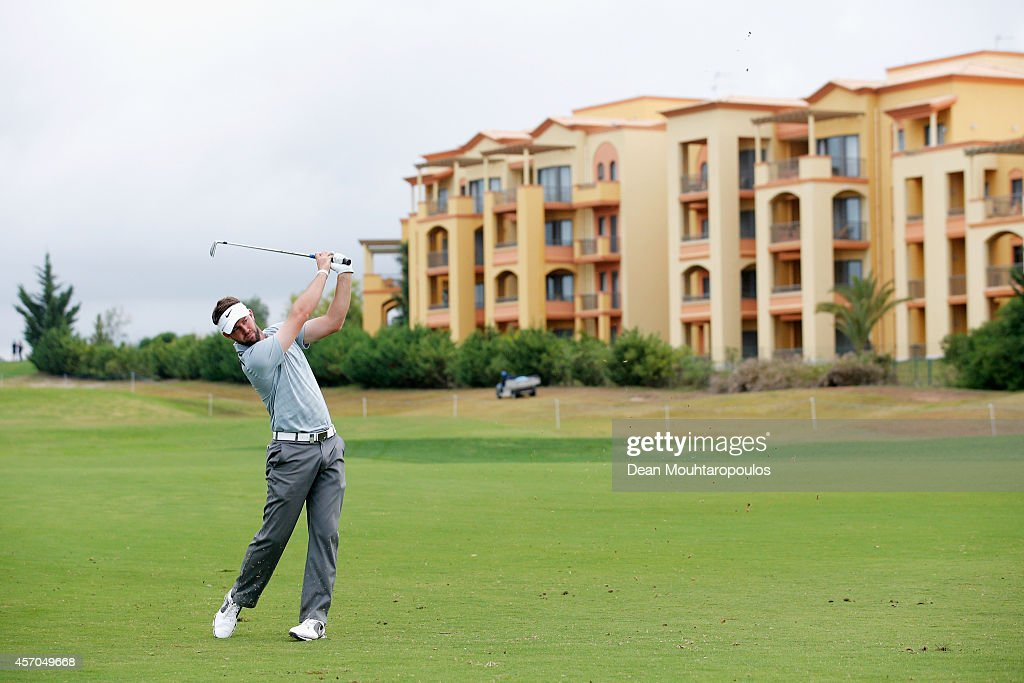 Scott Jamieson of Scotland hits his second shot on the 9th hole during Day 3 of the Portugal Masters held at the Oceanico Victoria Golf Course on...