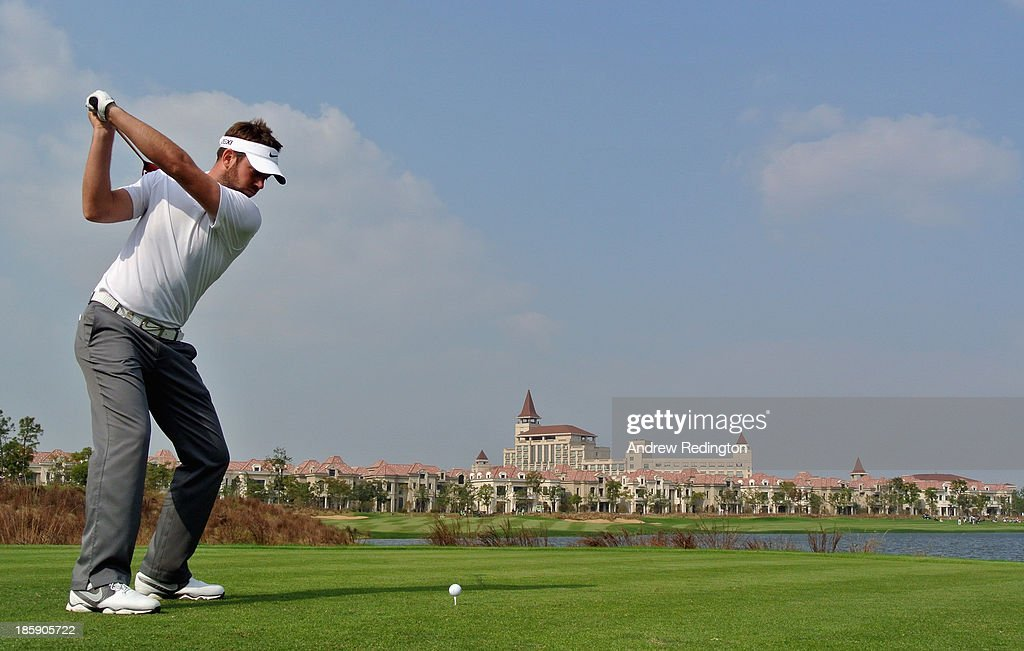 Scott Jamieson of Scotland hits his tee-shot on the ninth hole during the third round of the BMW Masters at Lake Malaren Golf Club on October 26, 2013 in Shanghai, China.