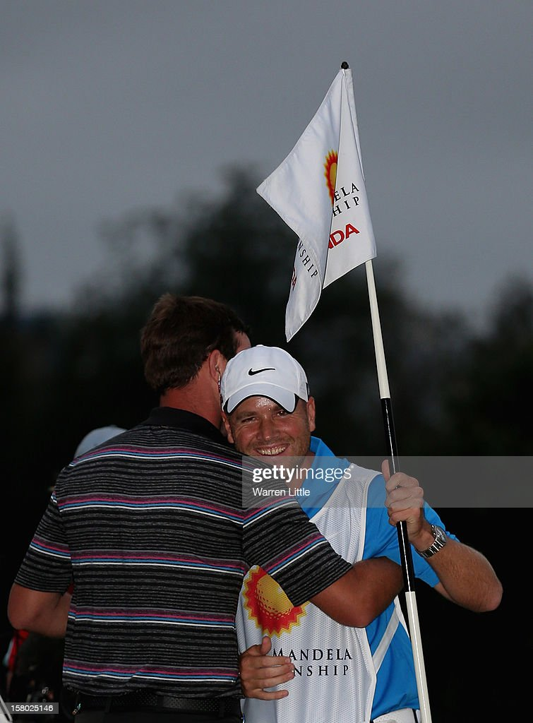 Scott Jamieson of Scotland is congratulated by his caddie after winning The Nelson Mandela Championship presented by ISPS Handa after a three way play-off against Steve Webster of England and Eduardo de la Riva of Spain at Royal Durban Golf Club on December 9, 2012 in Durban, South Africa.