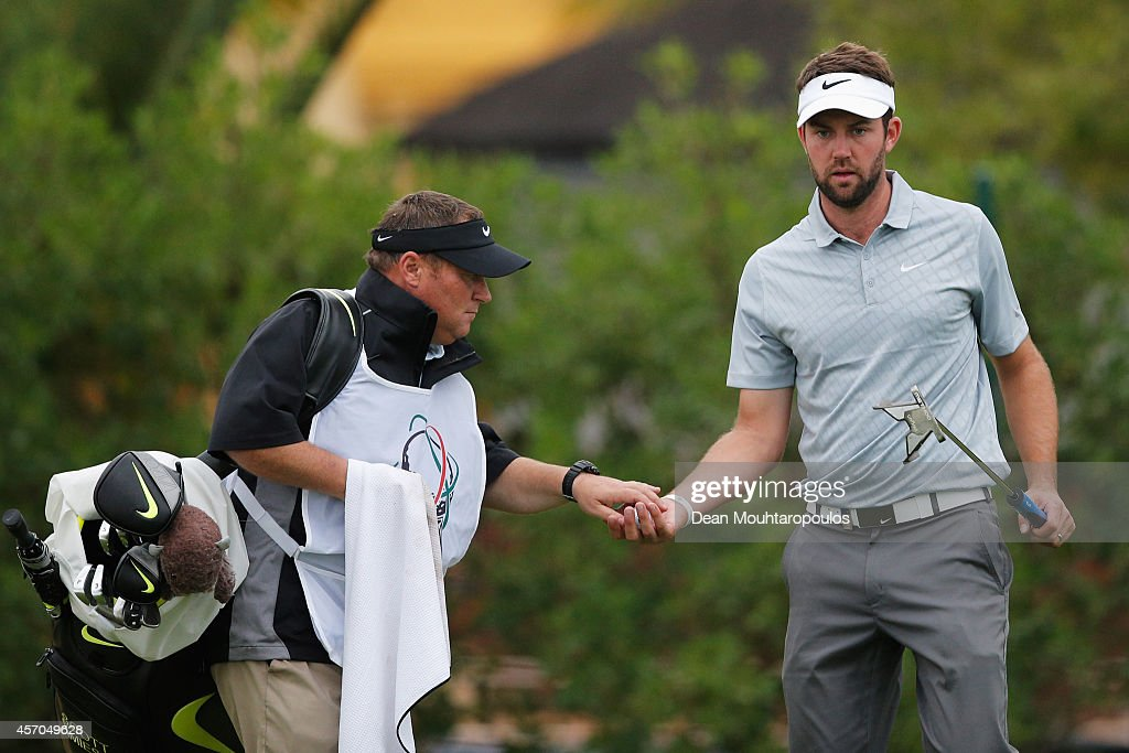 Scott Jamieson of Scotland is handed his ball on the 8th green during Day 3 of the Portugal Masters held at the Oceanico Victoria Golf Course on...