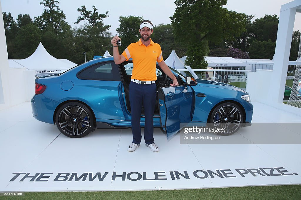 <a gi-track='captionPersonalityLinkClicked' href=/galleries/search?phrase=Scott+Jamieson+-+Golfer&family=editorial&specificpeople=10066796 ng-click='$event.stopPropagation()'>Scott Jamieson</a> of Scotland poses with his new BMW M2 car after his hole-in-one on the 10th during day two of the BMW PGA Championship at Wentworth on May 27, 2016 in Virginia Water, England.