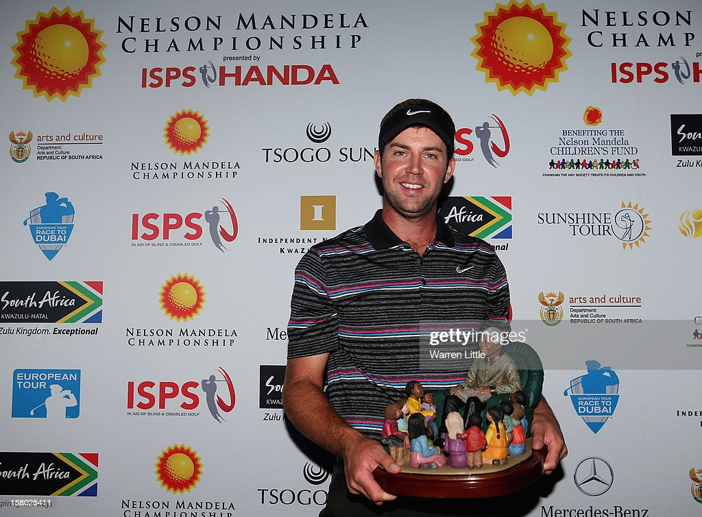 Scott Jamieson of Scotland poses with the trophy after winning The Nelson Mandela Championship presented by ISPS Handa in a three way play-off against Steve Webster of England and Eduardo de la Riva of Spain at Royal Durban Golf Club on December 9, 2012 in Durban, South Africa.