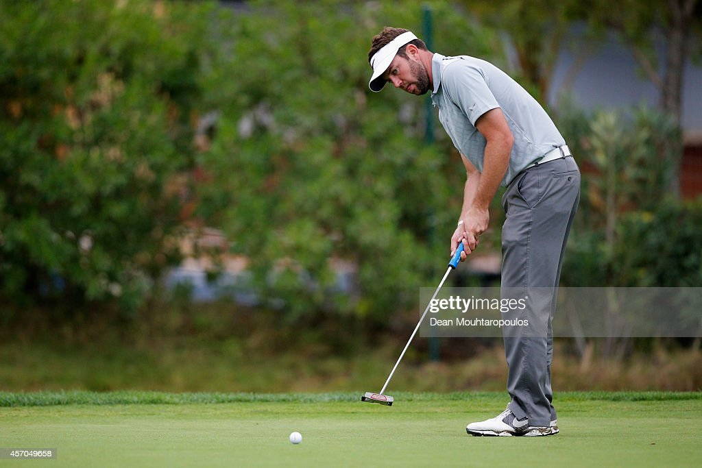 Scott Jamieson of Scotland putts on the 8th green during Day 3 of the Portugal Masters held at the Oceanico Victoria Golf Course on October 11 2014...