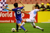 Scott Jamieson of Sydney FC competes the ball with Wu Xi of Shanghai Shenhua during the AFC Champions League Group H match between Shanghai Shenhua...