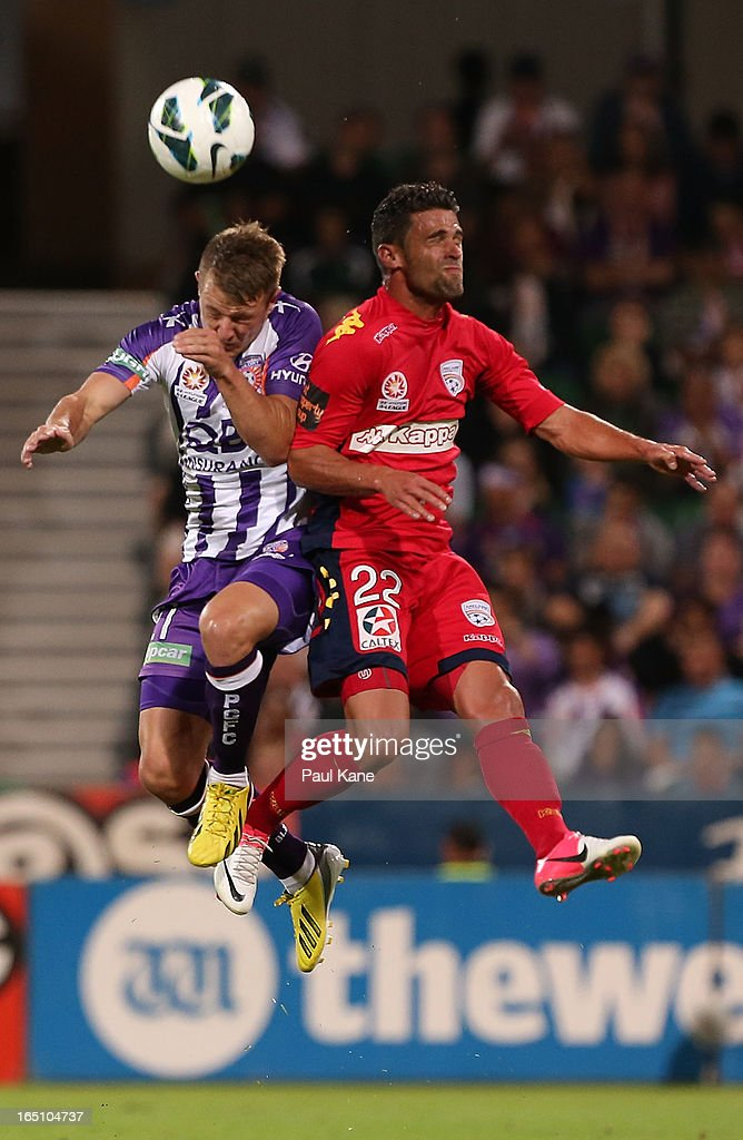 Scott Jamieson of the Glory and Fabio Ferreira of Adelaide contest for the ball during the round twenty seven A-League match between Perth Glory and Adelaide United at nib Stadium on March 30, 2013 in Perth, Australia.