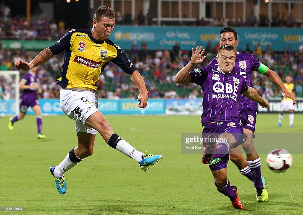 Scott Jamieson of the Glory attempts to block a pass by Mitchell Duke of the Mariners during the round seven A-League match between Perth Glory and the Central Coast Mariners at nib Stadium on November 23, 2013 in Perth, Australia.