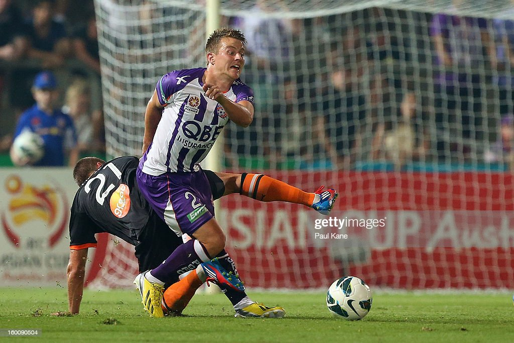 Scott Jamieson (R) of the Glory is tackled by James Meyer of the Roar during the round 18 A-League match between the Perth Glory and the Brisbane Roar at nib Stadium on January 26, 2013 in Perth, Australia.