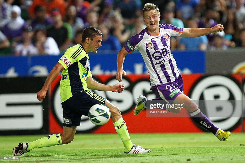 Scott Jamieson of the Glory looks to challenge Diogo Ferreira for the ball during the round 17 A-League match between the Perth Glory and the Melbourne Victory at nib Stadium on January 19, 2013 in Perth, Australia.