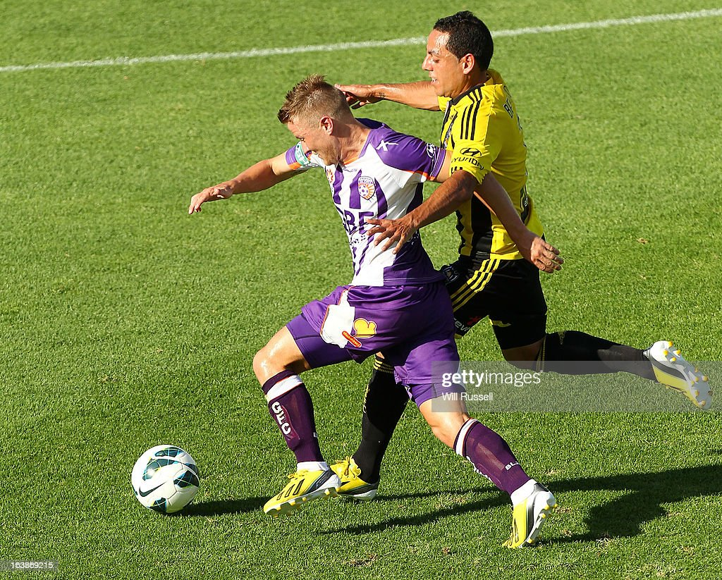 Scott Jamieson of the Perth Glory tackles <a gi-track='captionPersonalityLinkClicked' href=/galleries/search?phrase=Leo+Bertos&family=editorial&specificpeople=591591 ng-click='$event.stopPropagation()'>Leo Bertos</a> of the Wellington Phoenix during the round 25 A-League match between the Perth Glory and the Wellington Phoenix at nib Stadium on March 17, 2013 in Perth, Australia.
