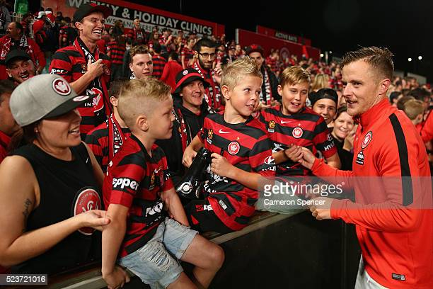 Scott Jamieson of the Wanderers signs autographs for fans after winning the ALeague Semi Final match between the Western Sydney Wanderers and the...