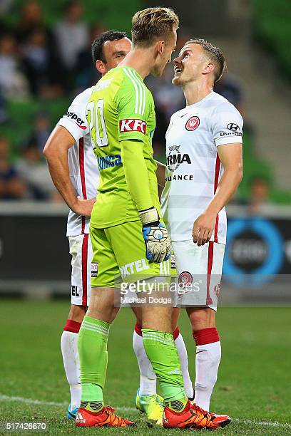 Scott Jamieson of the Wanderers stands toe to toe with Victory goalkeeper Lawrence Thomas during the round 25 ALeague match between the Melbourne...