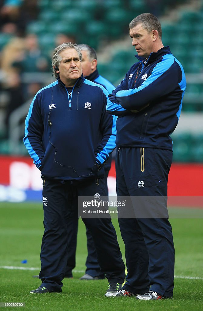 Scott Johnson the Scotland interim head speaks with Dean Ryan the Scotland interim forwards coach look on prior to kickoff during the RBS Six Nations match between England and Scotland at Twickenham Stadium on February 2, 2013 in London, England.