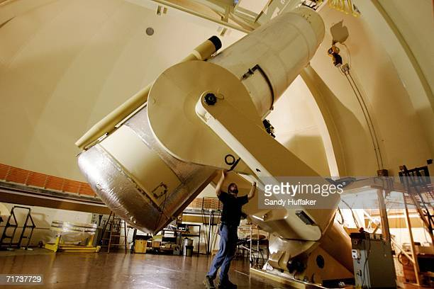 W Scott Kardel looks over a Oschin 48 inch telescope at the Palomar Observatory on August 28 outside of San Diego California Scientists at the...