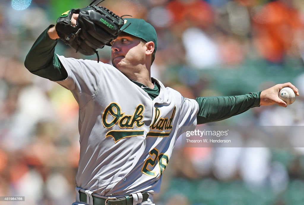 Scott Kazmiir #26 of the Oakland Athletics pitches in the bottom of the first inning against the San Francisco Giants at AT&T Park on July 10, 2014 in San Francisco, California.
