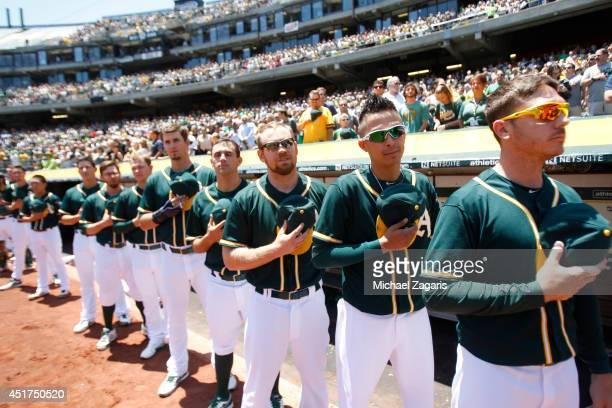 Scott Kazmir Jesse Chavez Brandon Moss and Brad Mills of the Oakland Athletics stand for the anthem prior to the game against the Boston Red Sox at...