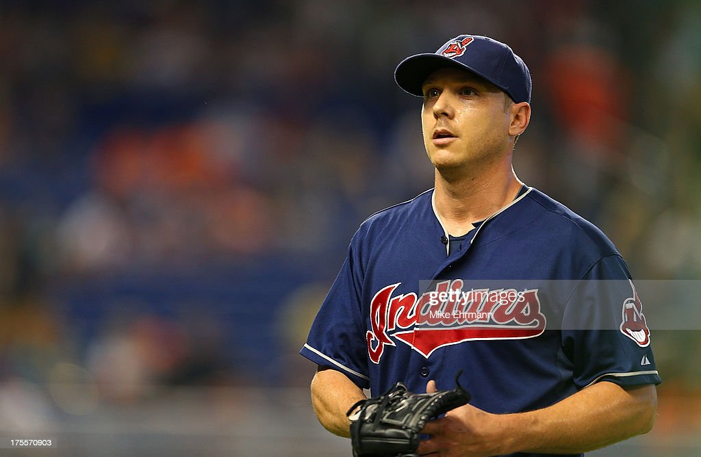 <a gi-track='captionPersonalityLinkClicked' href=/galleries/search?phrase=Scott+Kazmir&family=editorial&specificpeople=217724 ng-click='$event.stopPropagation()'>Scott Kazmir</a> #26 of the Cleveland Indians looks on during a game against the Miami Marlins at Marlins Park on August 4, 2013 in Miami, Florida.