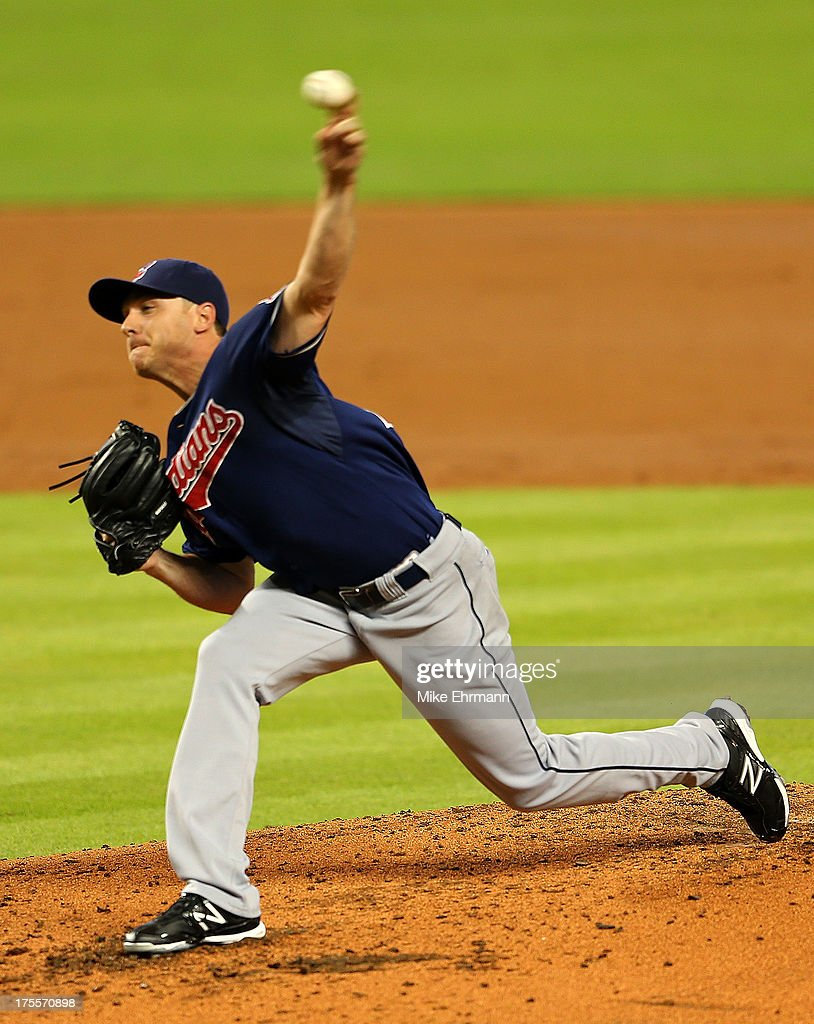 <a gi-track='captionPersonalityLinkClicked' href=/galleries/search?phrase=Scott+Kazmir&family=editorial&specificpeople=217724 ng-click='$event.stopPropagation()'>Scott Kazmir</a> #26 of the Cleveland Indians pitches during a game against the Miami Marlins at Marlins Park on August 4, 2013 in Miami, Florida.