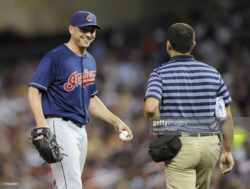 <a gi-track='captionPersonalityLinkClicked' href=/galleries/search?phrase=Scott+Kazmir&family=editorial&specificpeople=217724 ng-click='$event.stopPropagation()'>Scott Kazmir</a> #26 of the Cleveland Indians reacts as trainer Lonnie Soloff makes his way to the mound during the sixth inning of the game against the Minnesota Twins on July 19, 2013 at Target Field in Minneapolis, Minnesota.
