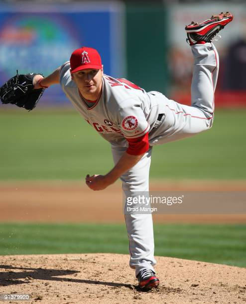 Scott Kazmir of the Los Angeles Angels of Anaheim pitches against the Oakland Athletics during the game at the OaklandAlameda County Coliseum on...