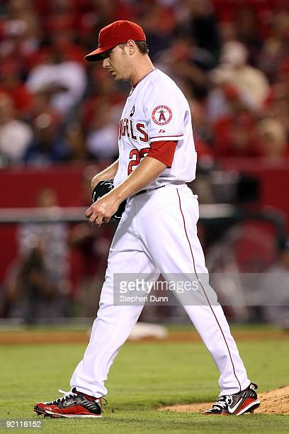 Scott Kazmir of the Los Angeles Angels of Anaheim walks off the mound during the fifth inning in Game Four of the ALCS against the New York Yankees...