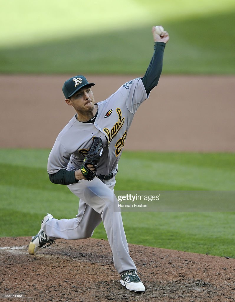 <a gi-track='captionPersonalityLinkClicked' href=/galleries/search?phrase=Scott+Kazmir&family=editorial&specificpeople=217724 ng-click='$event.stopPropagation()'>Scott Kazmir</a> #26 of the Oakland Athletics delivers a pitch against the Minnesota Twins during the fifth inning of the home opening game on April 7, 2014 at Target Field in Minneapolis, Minnesota. The Athletics defeated the Twins 8-3.