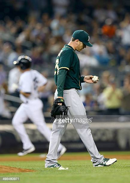 Scott Kazmir of the Oakland Athletics reacts as Mark Teixeira of the New York Yankees rounds third base in the sixth inning on June 3 2014 at Yankee...