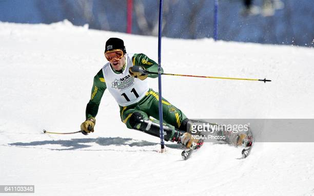 Scott Kennison of the University of Vermont races to a third place finish in the men's slalom during the Division 1 Men's Skiing Championship held at...