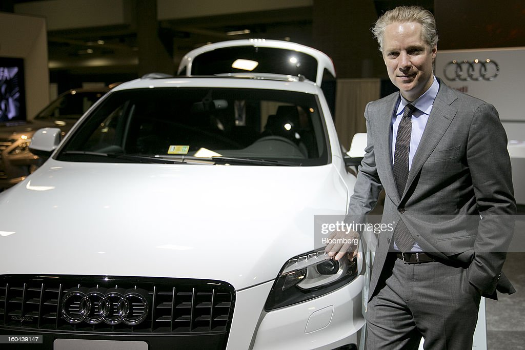Scott Keogh, president of Audi of America Inc., stands for a photograph next to an Audi AG Q7 TDI sport-utility vehicle at the Washington Auto Show in Washington, D.C., U.S., on Thursday, Jan. 31, 2013. Robert Bosch GmbH announced today at the auto show that its clean diesel technology will be featured in four new Audi TDI models now in the U.S. market. Photographer: Andrew Harrer/Bloomberg via Getty Images