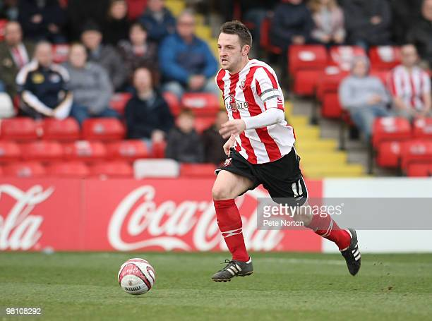 Scott Kerr of Lincoln City in action during the Coca Cola League Two Match between Lincoln City and Northampton Town at Sincil Bank Stadium on March...