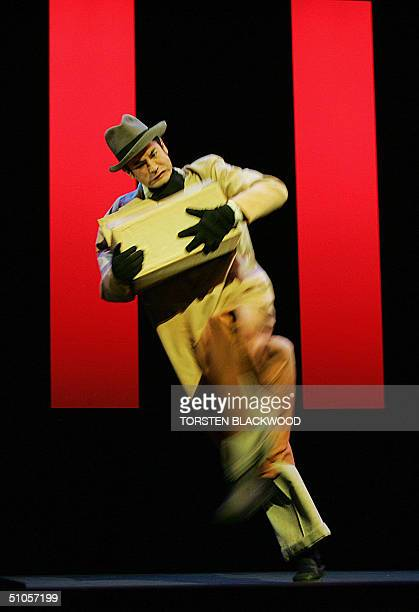 Scott Koehler of The Sydney Theatre Company performs 'Vanishing Point' by French master illusionist and magician Philippe Genty in Sydney 14 July...