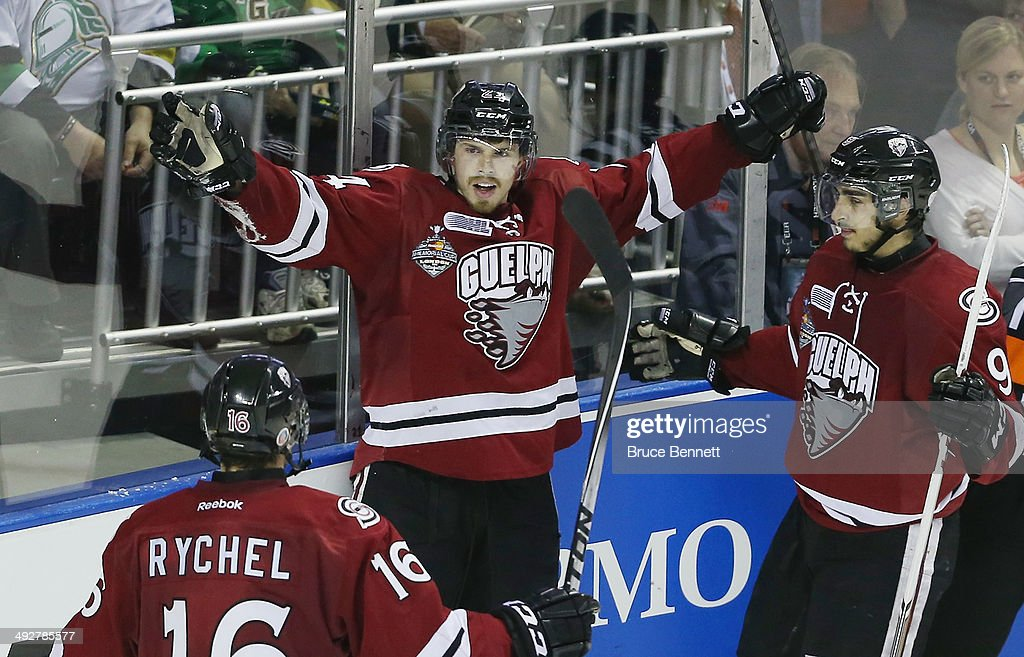 Scott Kosmachuk #24 of the Guelph Storm (C) celebrates his third goal of the game against the London Knights during the 2014 Memorial Cup tournament at Budweiser Gardens on May 21, 2014 in London, Ontario, Canada.