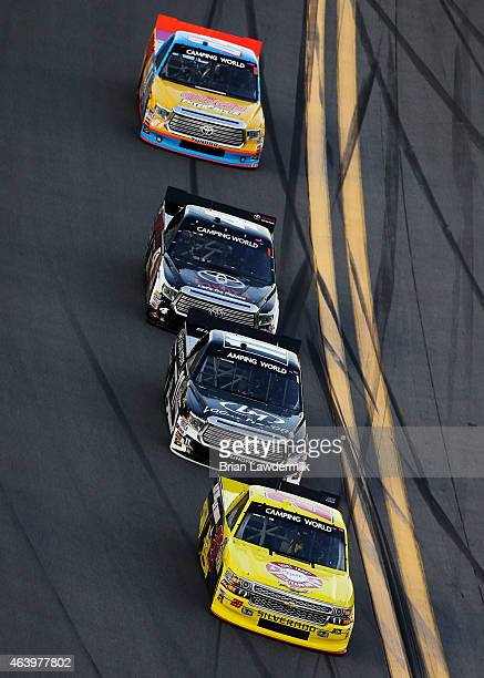 Scott Lagasse Jr driver of the Alert Today FL/Boy Scouts of America Chevrolet leads a pack of trucks during qualifying for the NASCAR Camping World...