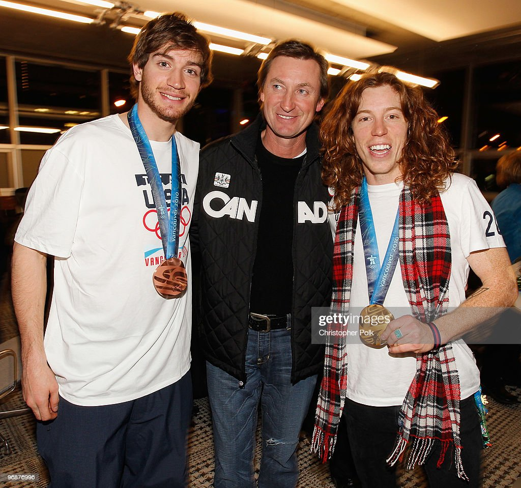Scott Lago (left) and Shaun White (right) of the United States snowboard team pose with hockey great <a gi-track='captionPersonalityLinkClicked' href=/galleries/search?phrase=Wayne+Gretzky+-+Ice+Hockey+Player&family=editorial&specificpeople=157520 ng-click='$event.stopPropagation()'>Wayne Gretzky</a> and their Olympic medals at the USA House on February 18, 2010 in Vancouver, Canada.