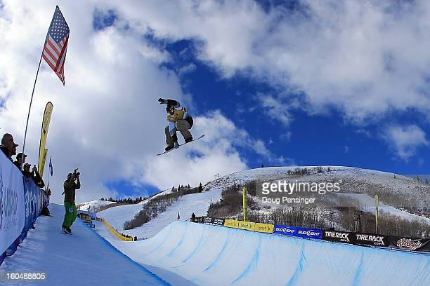 Scott Lago of the USA spins above the pipe as he finished second in the FIS Snowboard Halfpipe World Cup at the Sprint US Grand Prix at Park City...