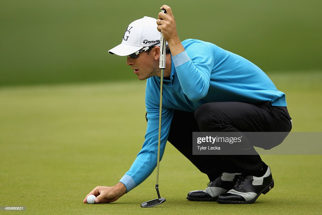 Scott Langley assesses a putt on the 1st green during the third round of the RBC Heritage at Harbour Town Golf Links on April 19 2014 in Hilton Head...